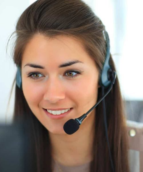 Female customer support operator with headset and smiling